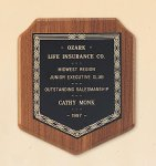 American Walnut Shield Plaque with a Black Brass Plate. Sales Awards